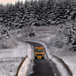 Snow falls on icy UK, causing treacherous conditions and travel warnings