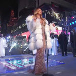 Mariah Carey Braves The Brutal Cold In Cleavage-Baring Evening Gown For NYE Performance