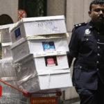 Bags and cash seized in Najib-linked raids