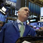 Stocks close mixed on earnings, trade concerns