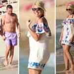 Holly Willoughby glows in kaftan as she enjoys a stroll with Dan down the beach