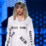 Taylor Swift shakes off feud and breaks record at American Music Awards
