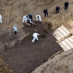 New York using mass graves amid outbreak