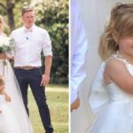 Little girl caught giving the middle finger during mum's wedding photoshoot