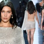 Bella Hadid showcases her ample cleavage in sheer ensemble during PFW