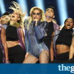 Lady Gaga keeps political poker face while singing of inclusion at Super Bowl