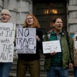 Revised 'extreme vetting' order drops language rejecting Syrian refugees, official says