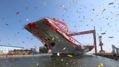 China launches aircraft carrier, boosting military presence – BBC News