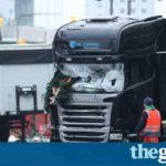 Merkel condemns Berlin market attack as police raid refugee shelter