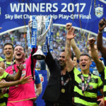 Huddersfield beat Reading on penalties to secure Premier League status after fairytale season
