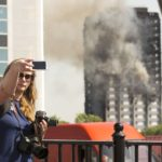 People are taking selfies at the site of the deadly London fire