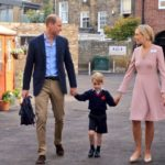 Prince George holds William's hand as he arrives for first day of school