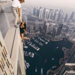 Model dangles 1000ft off skyscraper for a shoot with no safety equipment