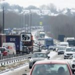 Leave work now before more snow causes travel chaos, commuters warned